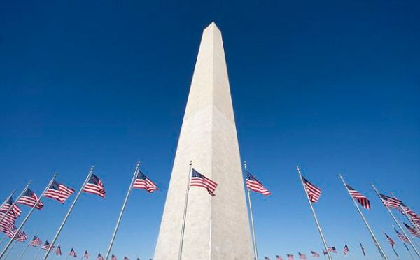 Washington Monument surrounded by American flags